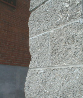 Split faced block exterior wall covering