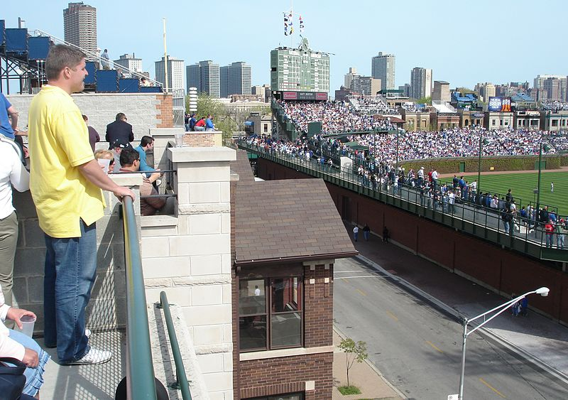 Looking at Wrigley Field from a roof deck vantage