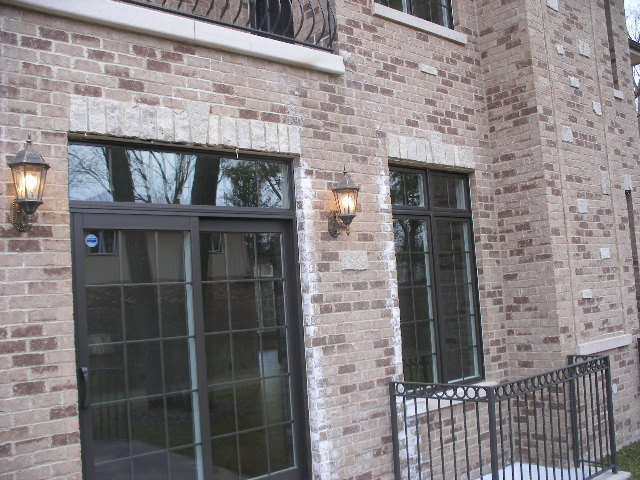 Improper brick veneer door and window flashing