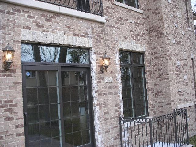 Improper brick veneer door and window flashing