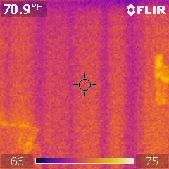Thermal image of wall, no insulation, with studs cooler