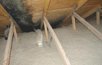 Mold and wood rot in an attic because the bathroom exhaust fan was not properly vented.