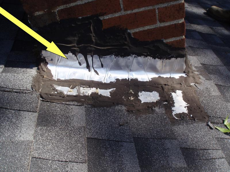 Non-professional installation of chimney flashing.  Plastic roofing cement should not be used in stead of proper metal flashing.