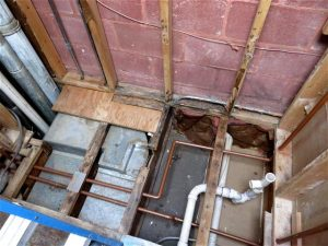 Notched OSB joist under bathtub